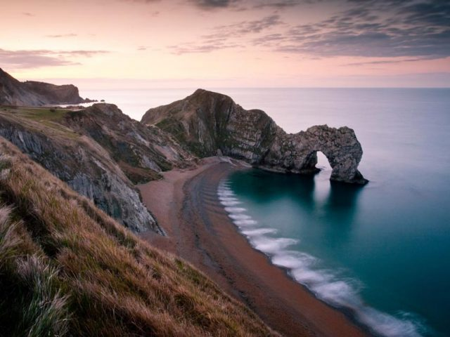 Moody sunset over the Dorset Jurassic coast at Durdle door