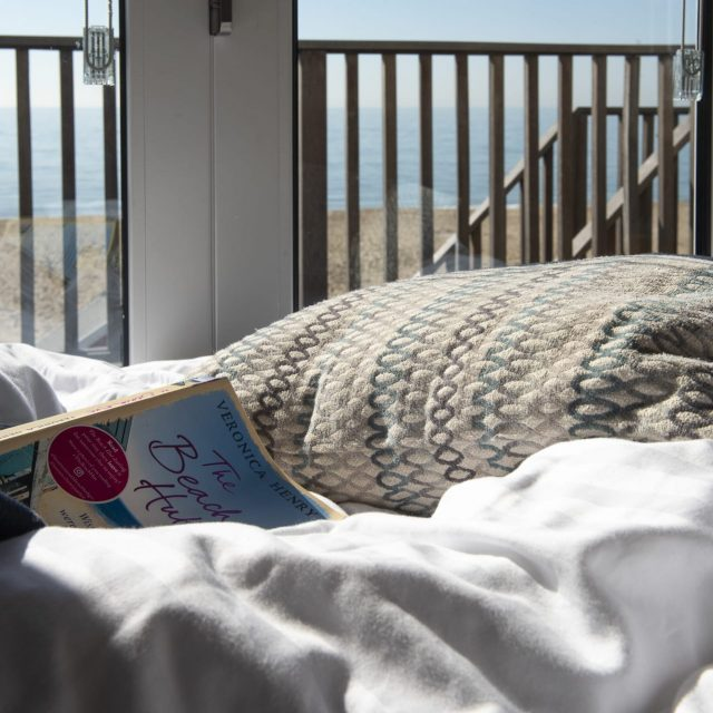 A book on a bed.