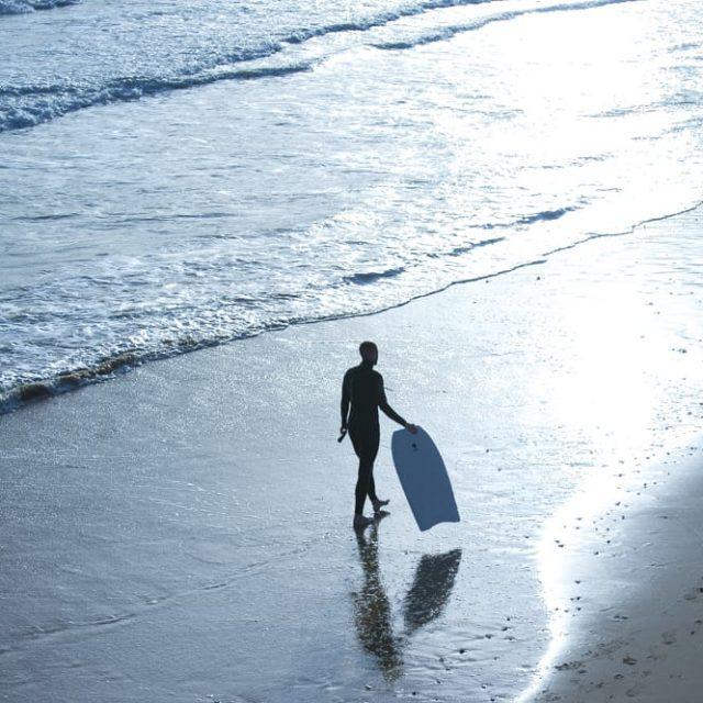 Bodyboarder on the beach