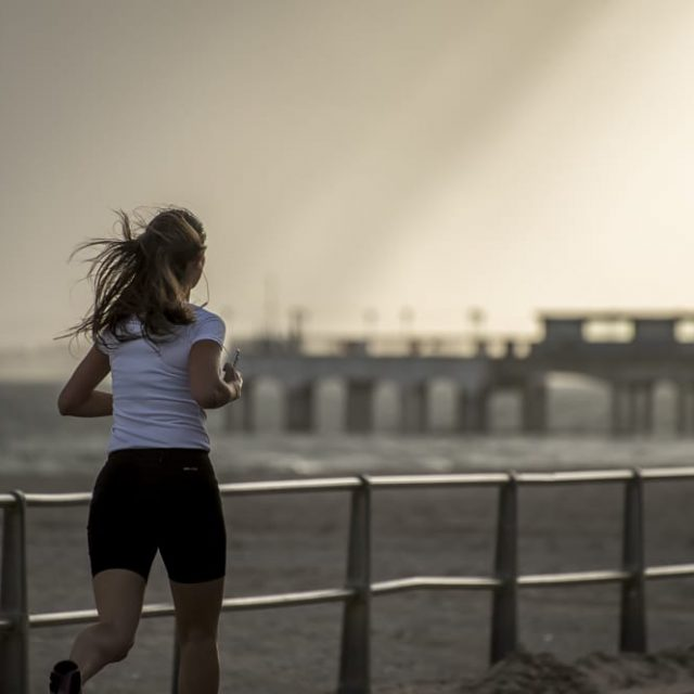 A woman jogs on Bournemouth Beach