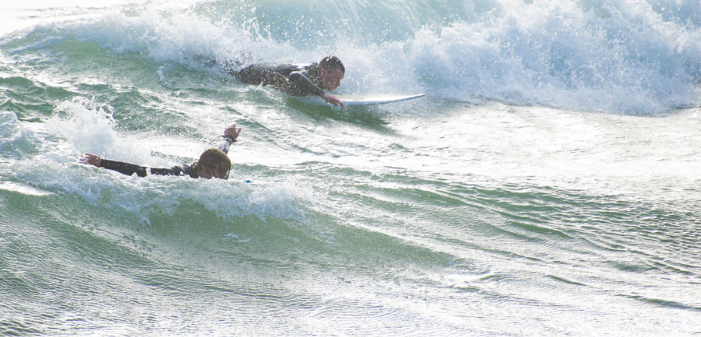 Surfers catching some waves at Boscombe beach