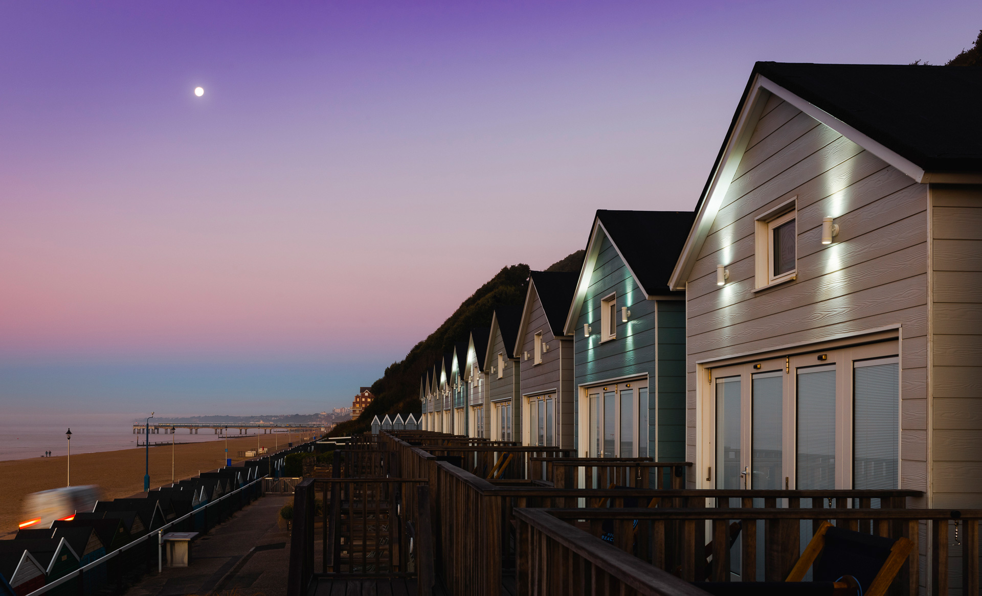 Moon and purple sky over the beach huts