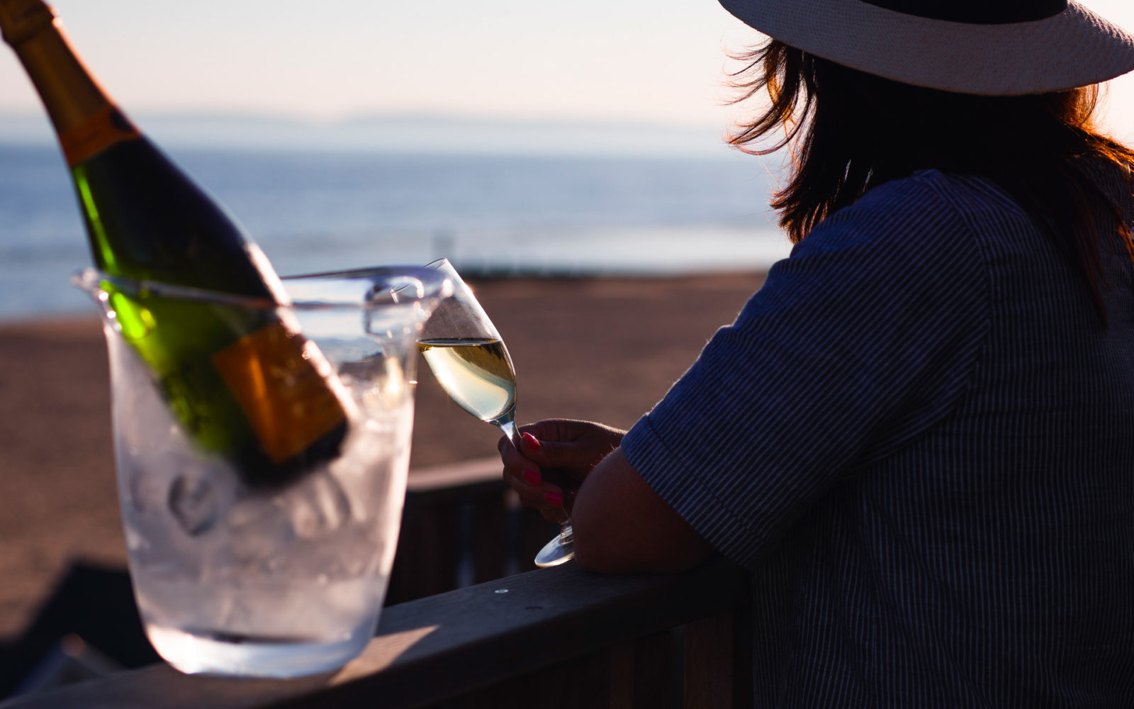 Guest enjoying a glass of bubbling whilst looking out over the boscombe beach