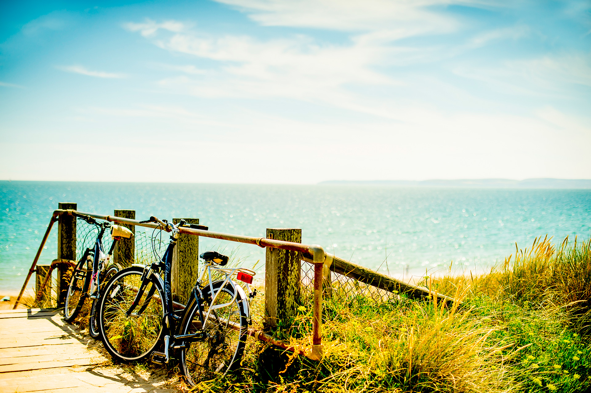 Bikes leaning on a fence on the overcliff