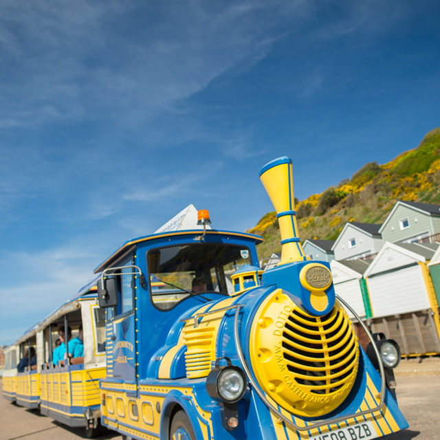 Yellow and blue land train that runs up and down the seafront