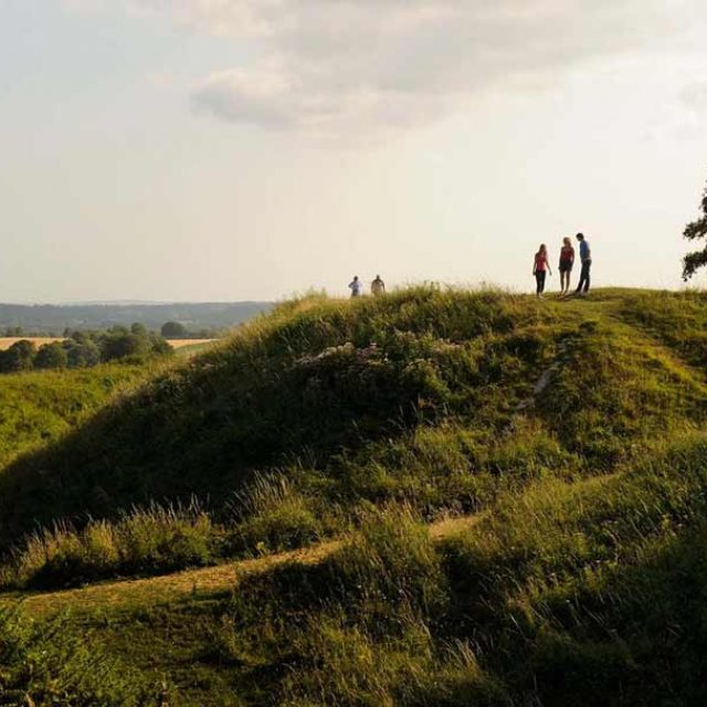 Visitors enjoying the views of badbury rings in Dorset