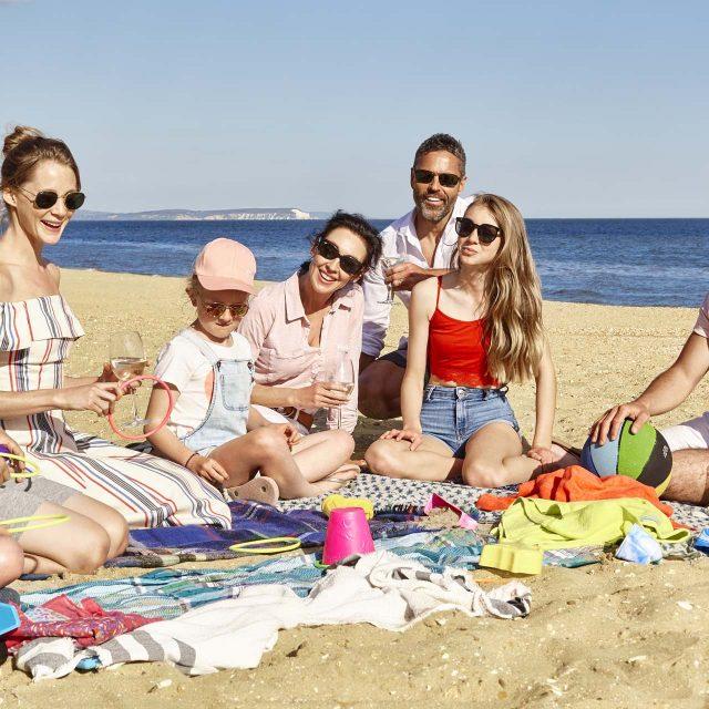 kids and grown -ups at beach picnic