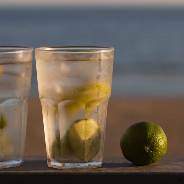 Two ice cold drinks sat perched on the Beach lodge decking with sea behind