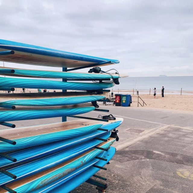 Surf boards racked up next to Bournemouth beach